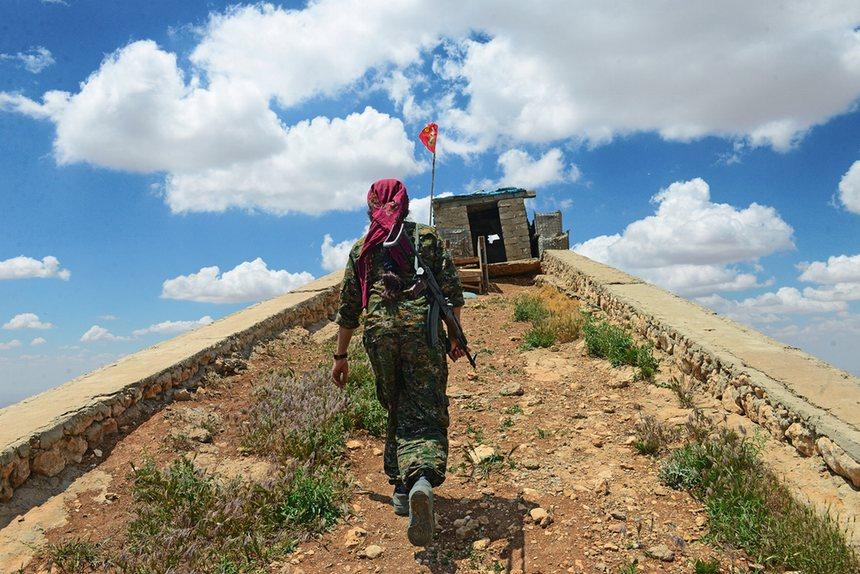 Yazidi woman sky...