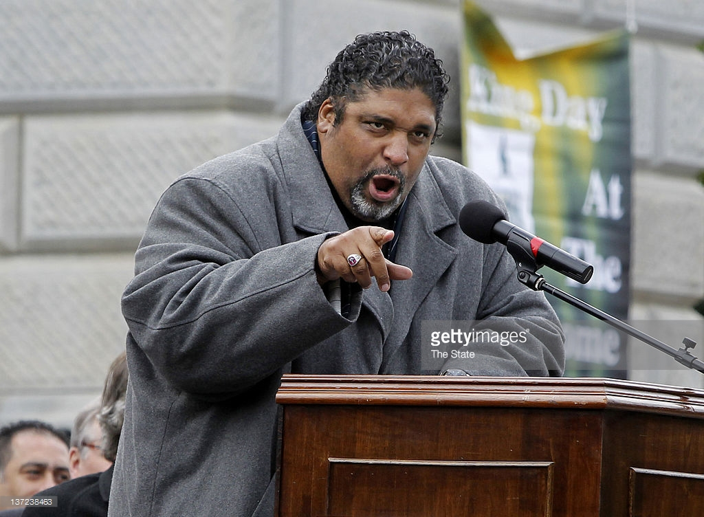 The Rev. Dr. William Barber II, president of the North Carolina chapter of the NAACP, addresses the crowd during the annual King Day at the Dome rally at the State House, Monday, January 16, 2012. The event featured a service at Zion Baptist Church and a march down Main Street towards the capitol. (Gerry Melendez/The State/MCT)